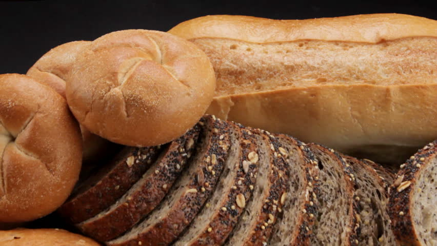 """Breads: Camera """"fly over"""" of various breads and baked goods, shot in HD video"""