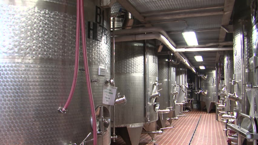 Stainless steel wine distilling vats at a large scale farm winery