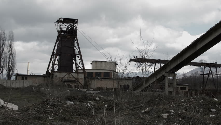 Old abandoned mining tower in post apocalyptic looking industrial area