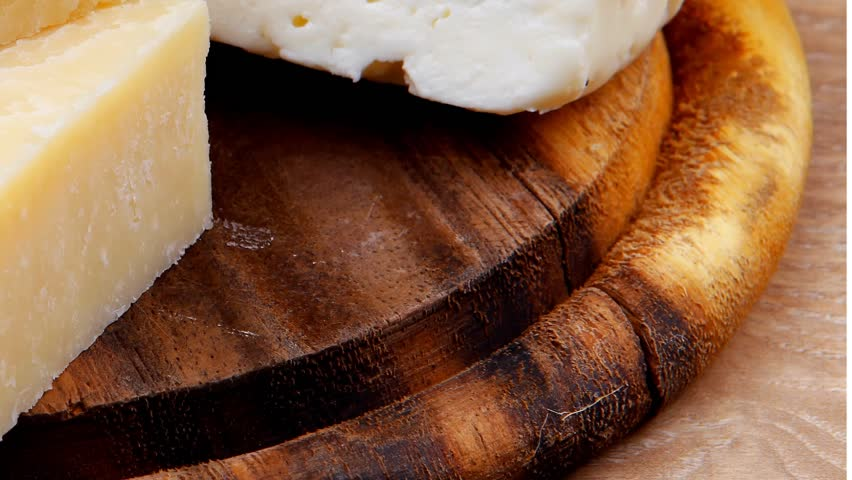 Various types of cheese on wooden platter over wooden table   Shutterstock HD Video #3769682