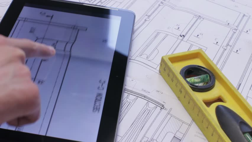 Engineer using Tablet PC while working with Blueprints. | Shutterstock HD Video #3769868