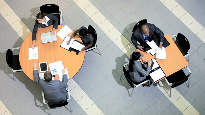 Overhead view of groups of multi ethnic business people holding meetings | Shutterstock HD Video #3771056