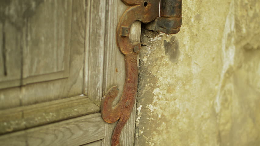 architectural detail of old medieval style  hinge on wood door #3775742