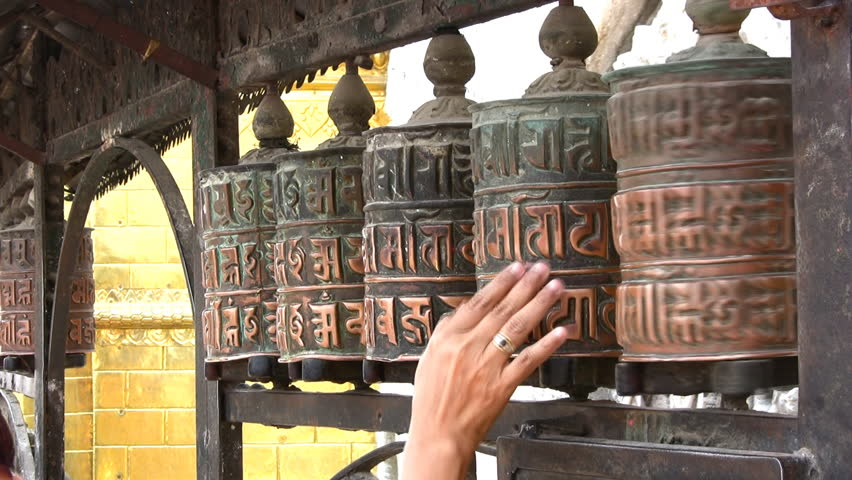Spinning Buddhist prayer wheels in Nepal