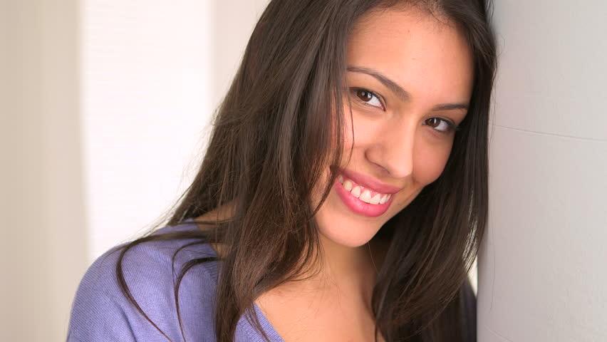 Latina woman smiling at camera