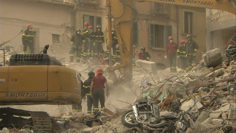 L'AQUILA, ITALY - CIRCA 2009: Recovery , construction crew uncovering rubble after the 2009 L'Aquila earthquake.