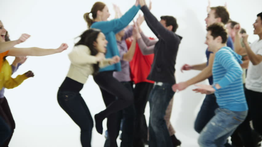 A happy and diverse multi ethnic group of people in colorful casual clothing run towards each other in a long line, cheering and celebrating. Isolated on white in a studio shot. In slow motion. | Shutterstock HD Video #3813923
