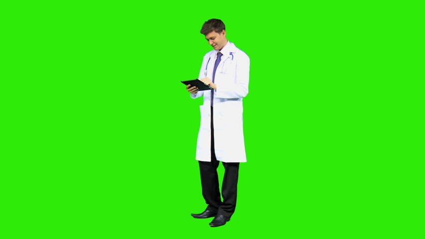 Male Caucasian junior hospital doctor wearing white coat stethoscope wireless touch screen tablet background green screen