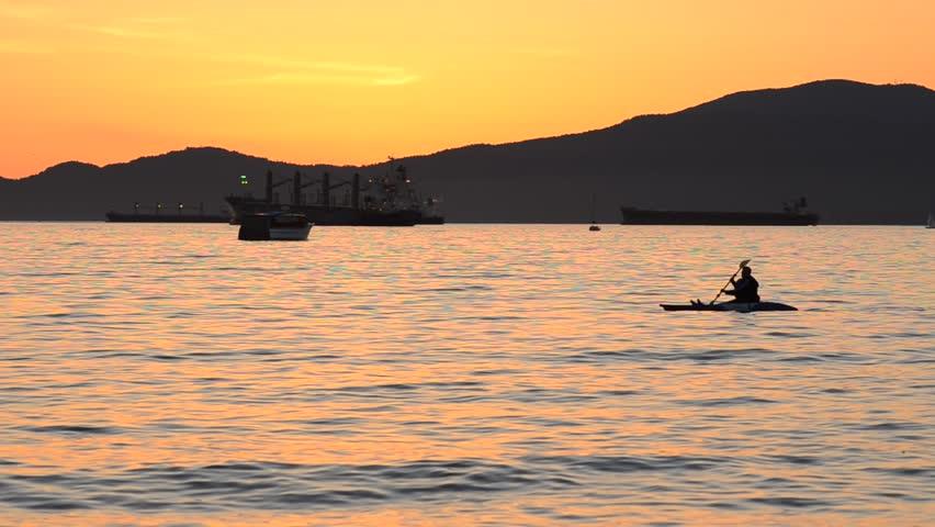 Paddling a kayak at dusk