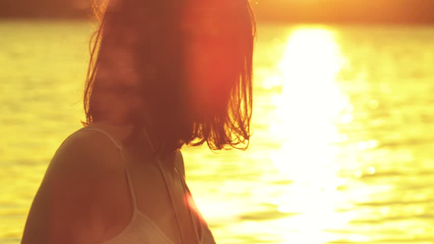Young woman watching the sunset, Shot on RED EPIC