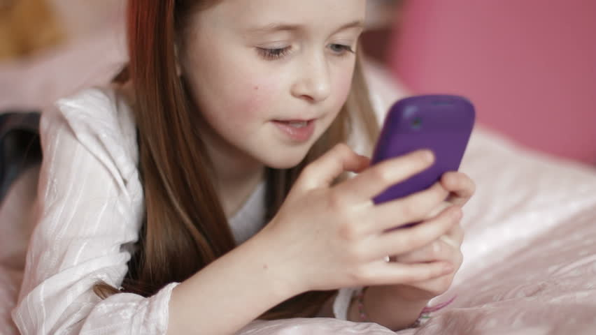 Image result for child on a phone stock