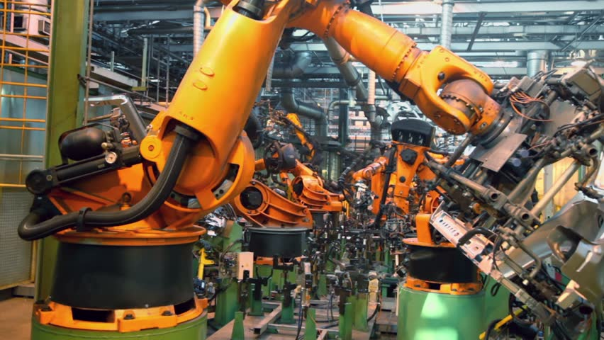 Robots weld car parts in production line at factory | Shutterstock HD Video #3851411
