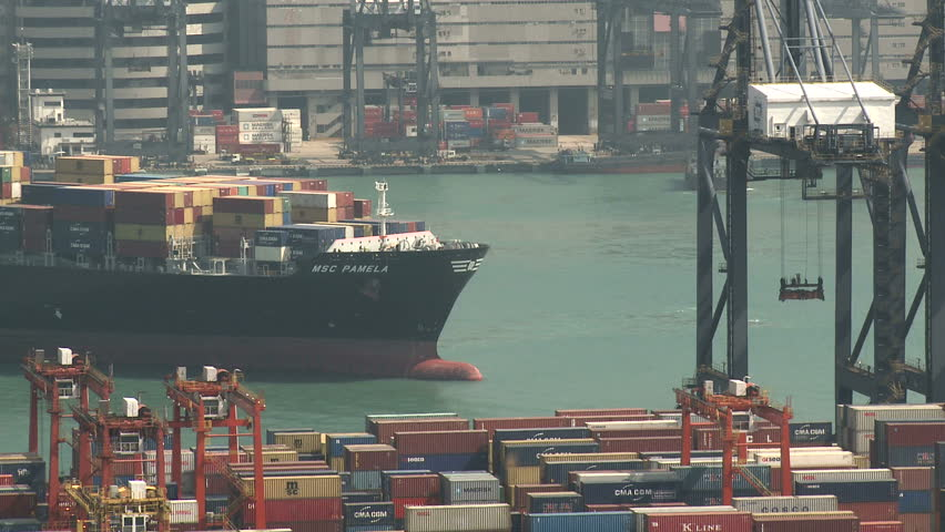 HONG KONG, CHINA - AUGUST 2012: Container Ship Arrives At Port. Shot overlooking Hong Kong container terminal in full HD on Sony EX1.