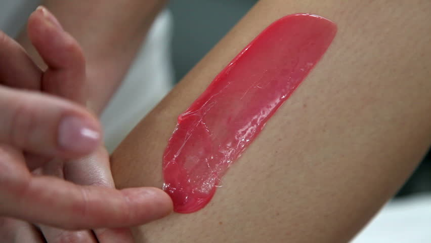 close up of a woman having waxed leg in a beauty spa
