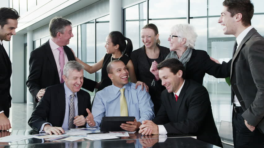 A diverse team of business people are awaiting news on the outcome of a project that they have been involved with. They find out that they have been successful. In slow motion.  | Shutterstock HD Video #3871640