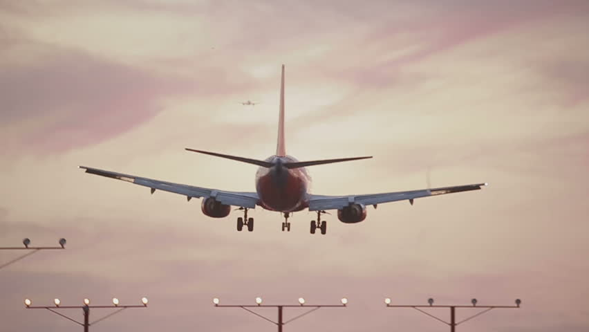 USA, Los Angeles - April 22: Landing Airplane at sunrise on April 22, 2013 in USA, Los Angeles.