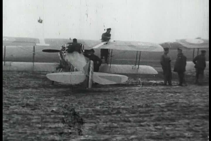 1910s - Eddie Rickenbacker and the 94th Aero Squadron roll out their fighting planes in World War One. | Shutterstock HD Video #3904262