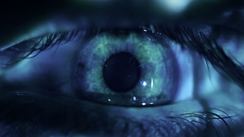 Macro video of a human eye with binary code projections