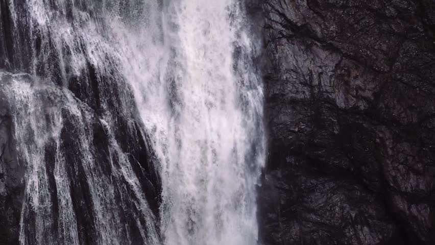 Slow motion shot of a natural waterfall. Shot in Scotland, UK.
