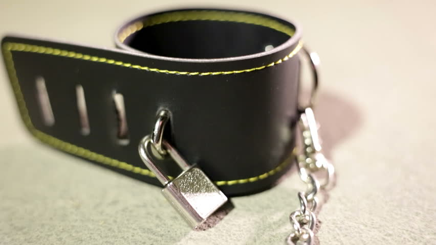 BDSM or dominance and submission for short bondage cuffs for restricting persons freedom, doing with it whatever the dominant partner wants. Quality leather cuffs with locks.