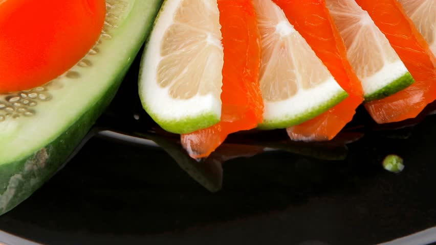 salmon slices and tomatoes on black plate 1920x1080 intro motion slow hidef hd