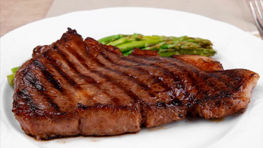 Meat Table Rare Medium Roast Beef Fillet With Asparagus Served Plate With Cutlery Over Wooden
