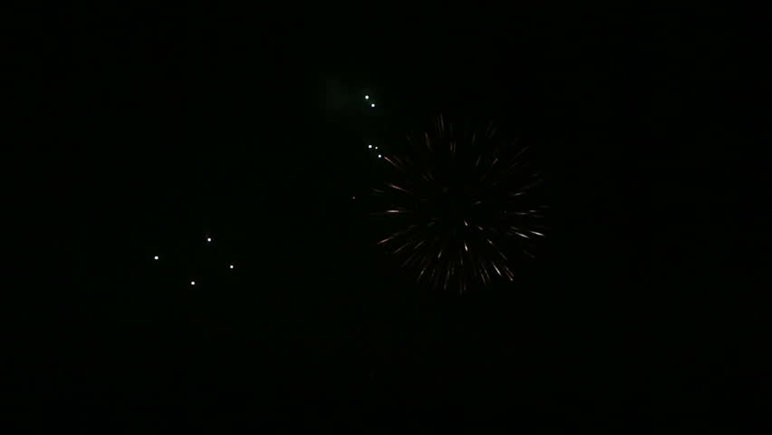 Beautiful fireworks in the night sky. | Shutterstock HD Video #3960742