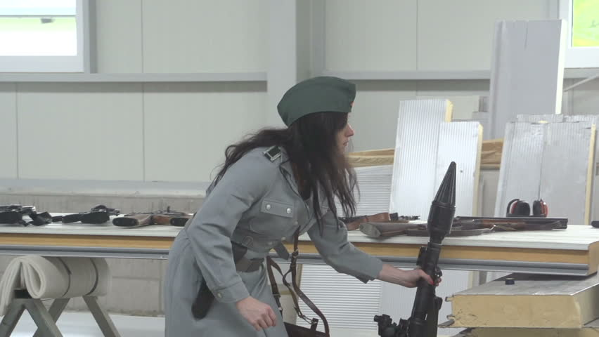 Female officer aiming with anti tank gun RPG7 in slow motion