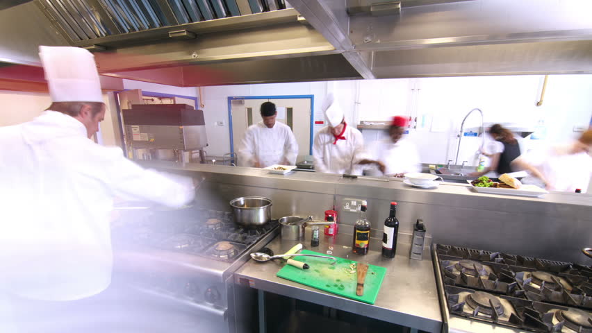 Restaurant Kitchen Video time lapse clip of a busy team of chefs, working hard and