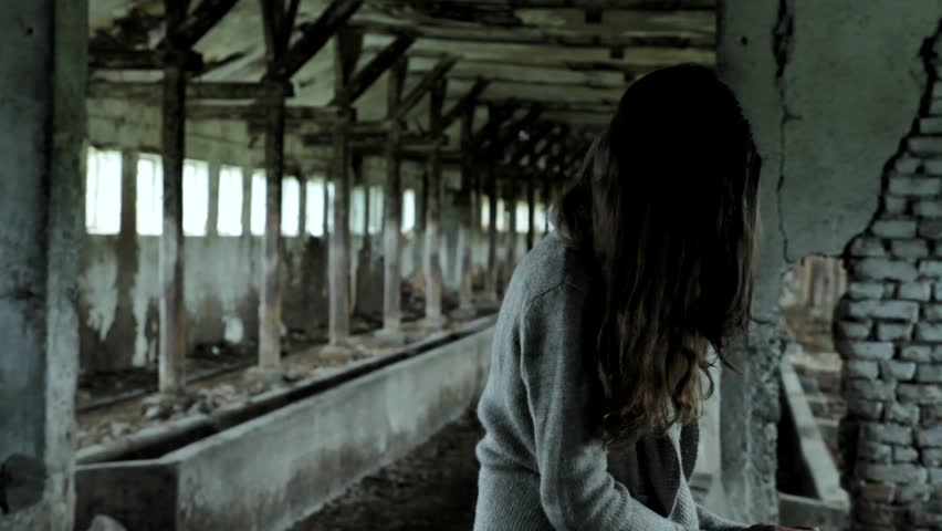 Girl Tortured by Mental Illness Sitting in Ruins Psychological Concept HD