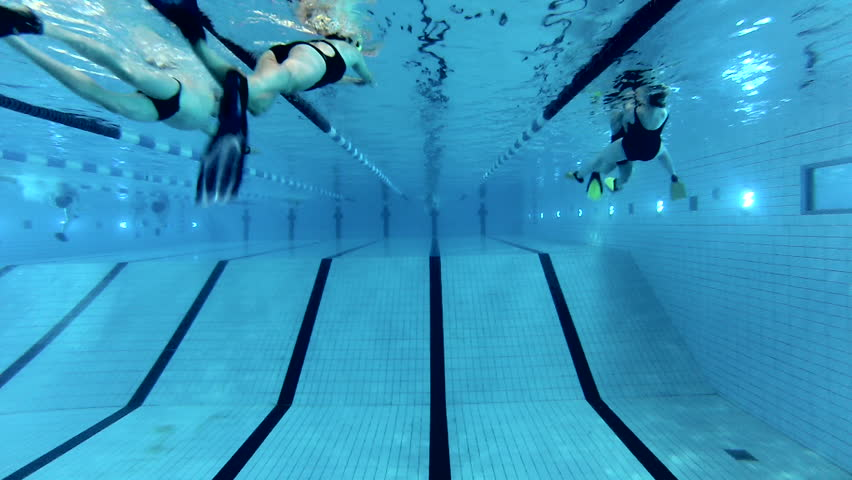 Olympic Swimming Pool Underwater moscow - apr 20: sportswomen touch border and make u-turn