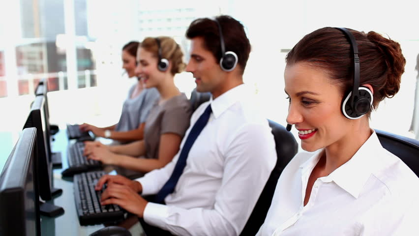office centre video. smiling call centre agents working with headset hd stock video clip office