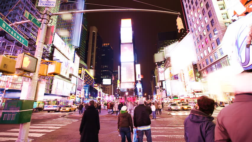 Time Lapse of busy street action on Times Square at night with brands blurred