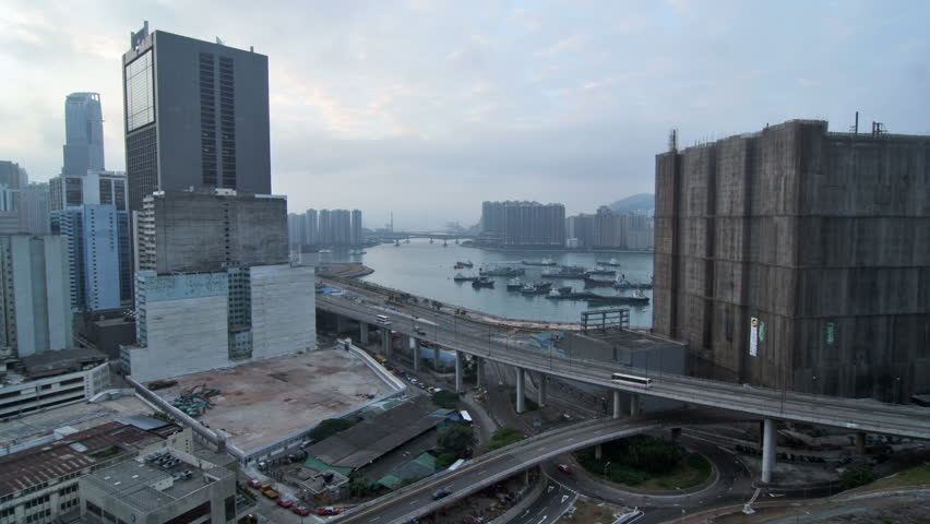 Hong Kong Cityscape Timelapse. Dawn of Tsuen Wan. Wide shot covering Rambler Channel between Tsing Yi and Kwai Chung with buildings at two sides. Busy traffic on highway and roundabout.