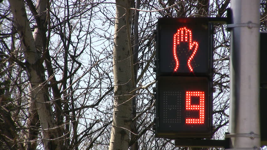 Traffic Lights Counting Down For Pedestrians