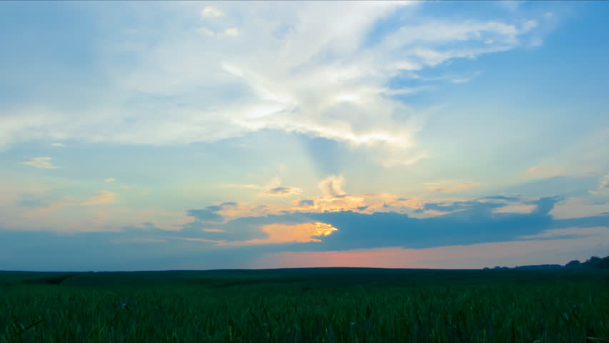 timelapse Sunset in the Sky over the fields