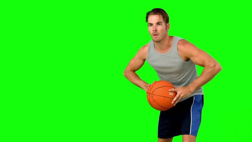 Basketball player passing the ball in slow motion on green screen #4049992