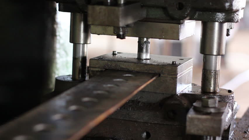 Factory repetitive moves, male stamping holes in iron steel bar