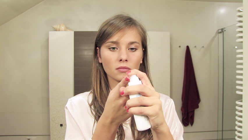 Beautiful blonde girl applying eye lotion - properly color-corrected version  | Shutterstock HD Video #4056847