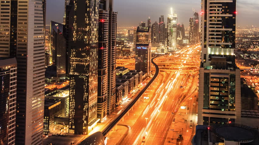 DUBAI, UNITED ARAB EMIRATES, MARCH 11th: Busy traffic scene in the rush hour on Sheikh Zayed Road, Dubai's main road artery. Transition time-lapse from dusk to night in Dubai, March 11 2011 #4088263