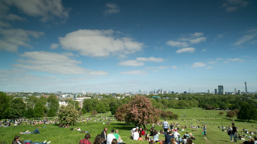 LONDON - JUNE 04:  Timelapse of crowds of people enjoying the views of the London skyline from primose hill on a sunny day. 04 June 2013, England.