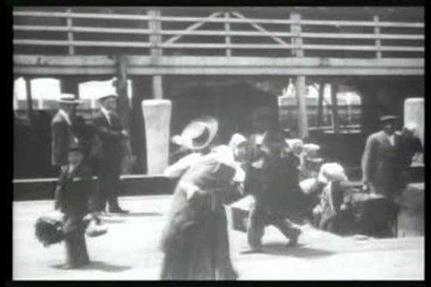 1900s - Immigrants arrive at Ellis Island, New York, in 1903.