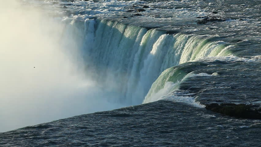 The Niagara River Flowing Over The Crest Line Of The Horseshoe Falls In Niagara Falls, Ontario, Canada The Largest Waterfall In North America