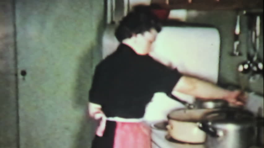 A grandmother prepares a delicious Christmas turkey dinner for her family in 1958.