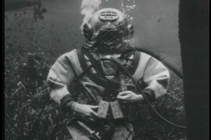 1930s Two Men Dress Another Man In Deep Sea Diving Gear Before A Dive During The 1930s Stock Footage Video 4221697 Shutterstock