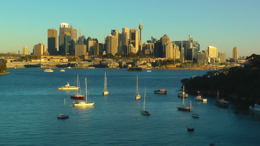 Time-lapse video of Sydney city skyline at late afternoon with rapid change of light