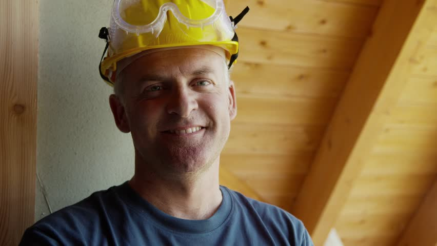 Man in construction site, portrait of happy manual worker smiling at camera in new building. Part 6 of 8