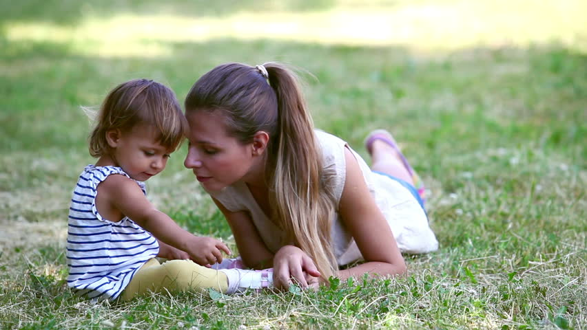 Playful mom and her child enjoying their weekend outdoors | Shutterstock HD Video #4228084