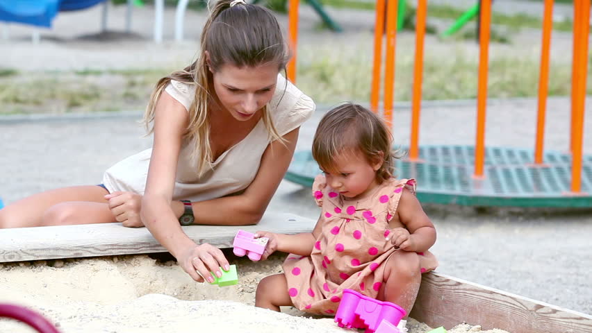 Charming family of two playing in the sandbox on a summer day | Shutterstock HD Video #4228102