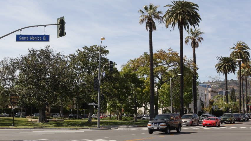LOS ANGELES, USA - APRIL 7, 2013 Car Traffic in Beverly Hills, Palm Trees, Santa Monica BLVD, Los Angeles, Boulevard, Commuters go to work